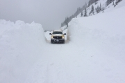 The pickup truck shows the depth of the avalanche deposit on Kootenay Pass Monday. — Photo courtesy West Kootenay District Ministry of Transportation & Infrastructure